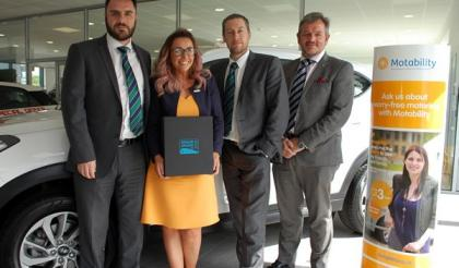 John Mulholland Hyundai celebrate Motability award for best customer service in the UK