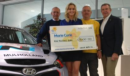 Motorsport event sees Marie Curie receive €5,000 donation